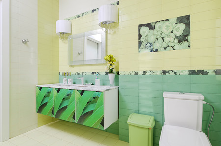 Bathroom design with beautiful grass print on bath cabinet and toilet Stock Photo