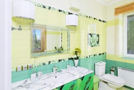 Bathroom design with beautiful green grass print on bath cabinet