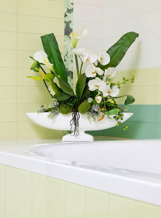 Beautiful white orchid flower decor in bathroom design