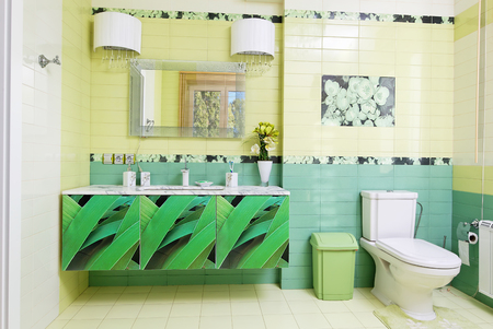 Modern bathroom design in green colors with orchid print