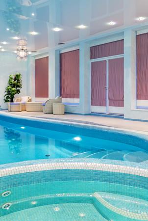 Relaxation spa zone near blue mosaic swimming pool Stock Photo