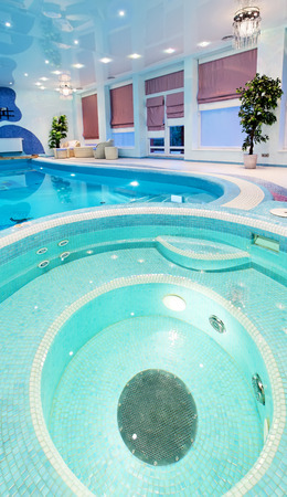 Round swimming pool design with blue mosaic