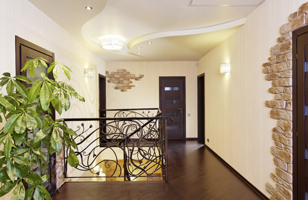 Classical stairs with ornamental handrail in hallway with doors