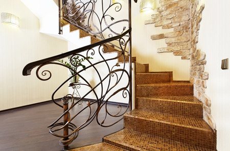 Classical mosaic stairs with ornamental handrail and stone decors