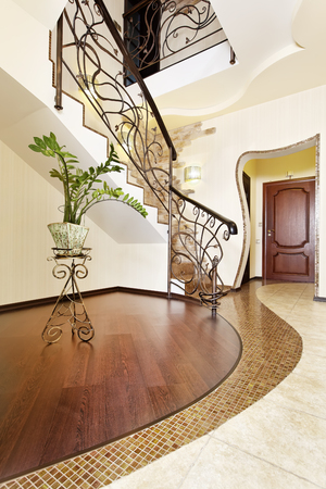 Classical mosaic stairs with ornamental handrail in hallway in yellow golden colors