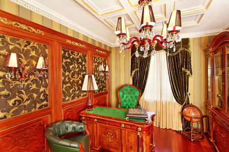Classical interior working space with antique furniture