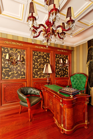 Classical interior ornate working space with chess
