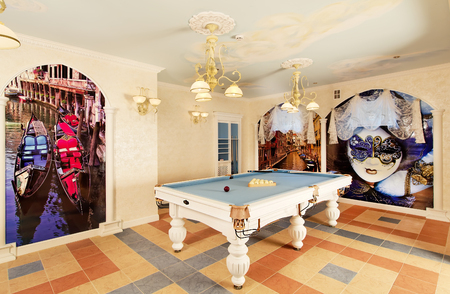Classical pool room interior with paintings