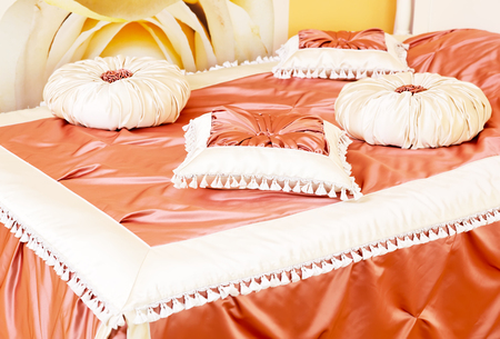 Classical satin pillows in apricot color