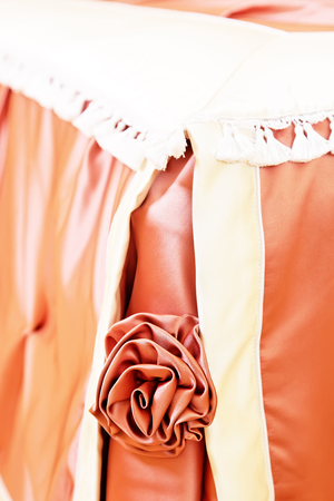 Artificial fabric rose bed decoration closeup