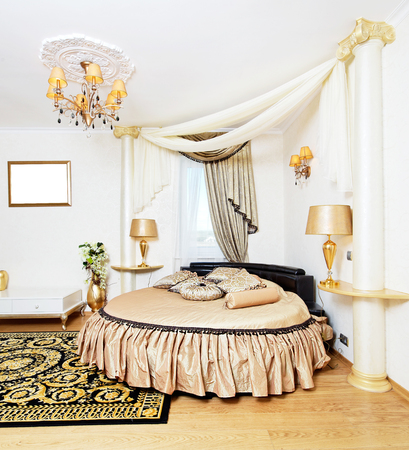 Cassical golden bedroom interior with round bed