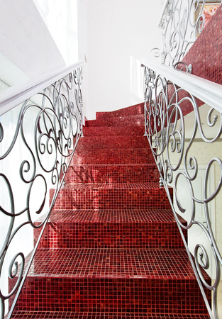 Classical mosaic stairs with beautiful handrail close up