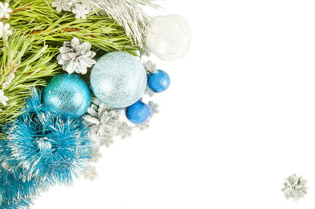 Fir tree branch and cones with blue balls and tinsel isolated on white background Stock Photo
