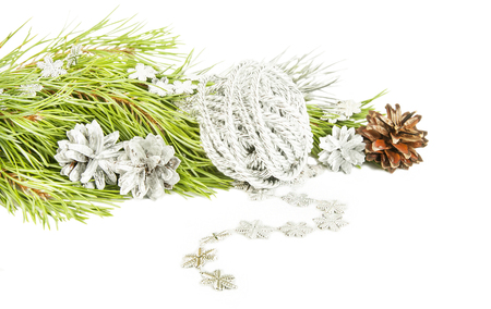 Fir tree branch, silver cones and star garland isolated on white background Stock Photo
