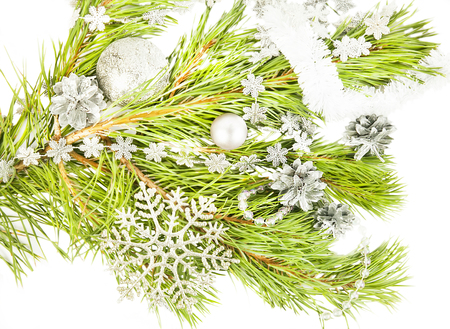 New year composition with fir tree, artificial snowflake and silver ball close up