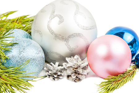 New year composition with fir tree, beautiful silver ball and silver cones close up Stock Photo