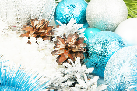 New year silver and blue decorations on white background close up