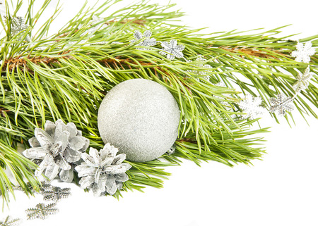 New year composition with fir tree, silver cones and ball close up