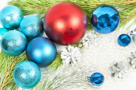 New year decorations on white background with balls and fir tree branch