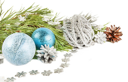 Christmas composition with fir tree branch, beautiful silver ball and silver cones Stock Photo