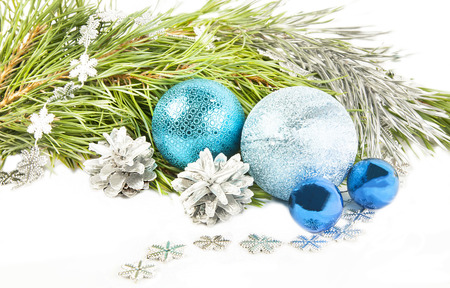 Christmas composition with fir tree branch, beautiful blue balls and silver cones