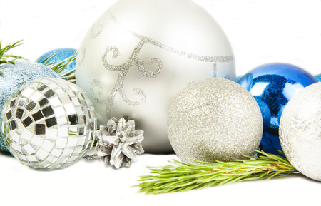 New year and Christmas composition with fir tree branch, beautiful silver ball and silver cones