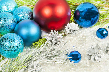 New year and Christmas decorations on white background with blue balls and fir tree branch