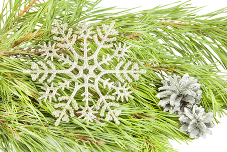 Artificial new year snowflake on fir tree branch background