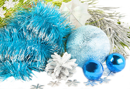 New year and Christmas composition with blue tinsel, fir tree on white Фото со стока