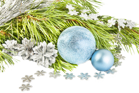 New year and Christmas composition with fir tree, cones and silver ball