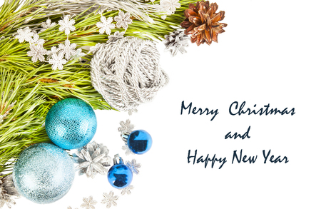 New Year composition with fir tree branch and cones with blue balls and tinsel isolated on white background