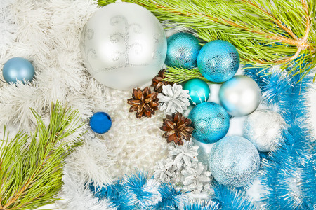New year and Christmas blue and white decorations and fir tree branch Фото со стока