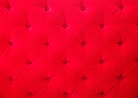 Red velvet fabric background pattern closeup