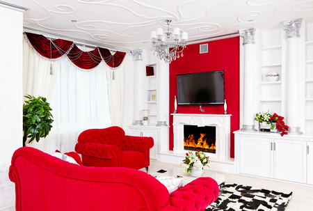 Classical red living room interior space with fire place and red furniture