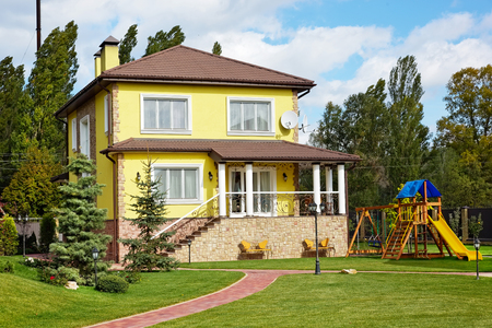 Luxury house with green yard and children playground and garden