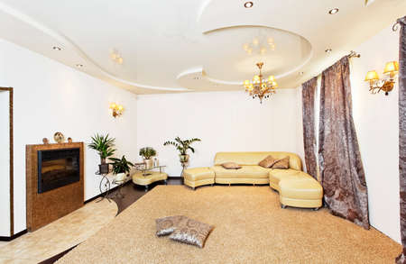 Living room hall modern design interiors in beige golden colors Stok Fotoğraf