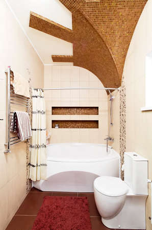 Bathroom design in beige colors with mosaic