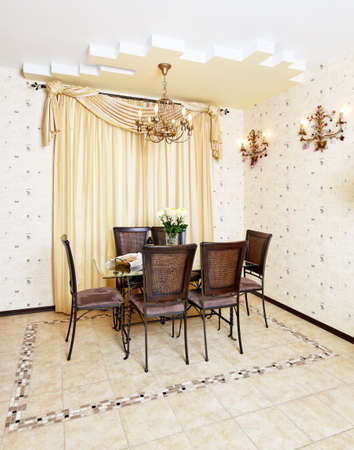 Dining room with table and chair in modern style kitchen in beige colors Stok Fotoğraf
