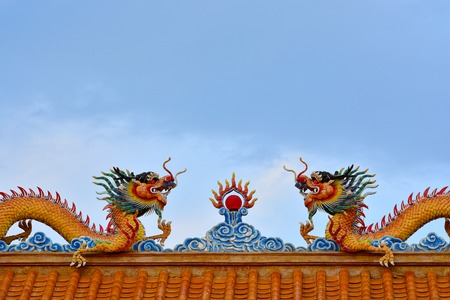 Two  Dragons status on roof of joss house photo