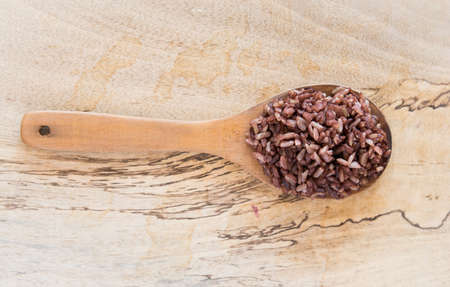 cooked rice: cooked rice on Wood Ladle. Wood splat Background Stock Photo
