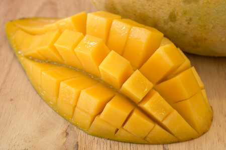 cubed: Fresh mango cut and cubed in its skin Stock Photo