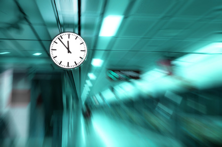 clock blurred ,conceptual image of time running or passing away effect  zoom out alarm clock to movements