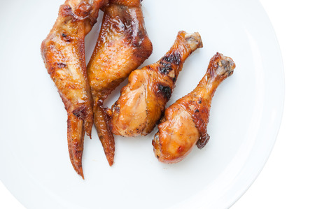 tasty grilled chicken wings skewers and chicken leg isolated on white background