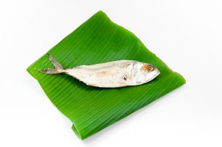 sardine: Fresh mackerel or tuna steamed fish on banana green leaf from sea on white background Stock Photo