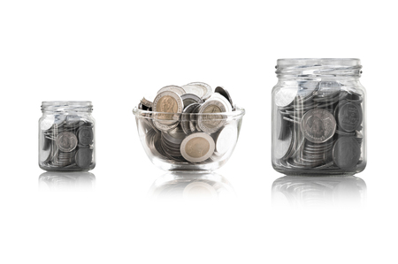 coins in a glass jar against ,savings coins - Investment And Interest Concept saving money concept, growing money on piggy bank. isolated on white background