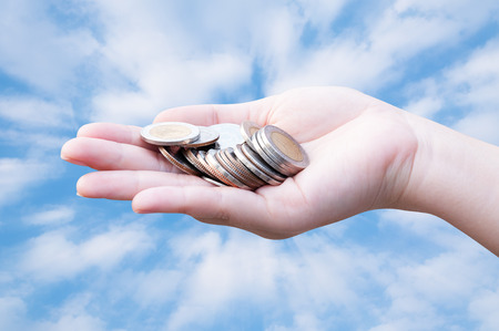 Coins in hands on blue sky,Donation Investment Fund Financial Support Charity  Dividend Market Growth Home House Stock Trust Wealthy Giving Planned Accounting Collection Debt Banking ROI concept