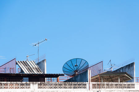 satelite: Satellite dish and television antenna on the old building with the blue sky background in the morning