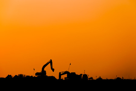 silhouette of excavator loader at construction site,Silhouette Backhoe,track-type loader excavator machine doing earthmoving