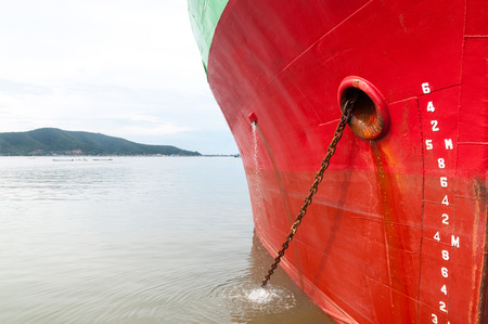 part of ship Large cargo ship  with many shipping container in harbor ,ship in harbor thailand Stock Photo