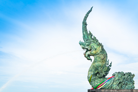 Naga statue spray water to the sea with blue sky background,samila-songkhla Thailand Stock Photo